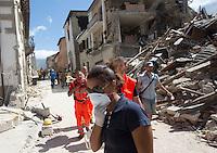Operators work on rubble of collapsed buildings in the village of Amatrice, central Italy, hit by a magnitude 6 earthquake at 3,36 am, 24 August 2016.<br /> Operatori al lavoro tra le macerie degli edifici crollati dopo il terremoto che alle 3,36 del mattino ha colpito Amatrice, 24 agosto 2016.<br /> UPDATE IMAGES PRESS/Riccardo De Luca