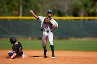 Dartmouth Big Green second baseman Blake Crossing (13) throws to first base as Masen Prososki (6) slides in during a game against the Omaha Mavericks on February 23, 2020 at North Charlotte Regional Park in Port Charlotte, Florida.  Dartmouth defeated Omaha 8-1.  (Mike Janes/Four Seam Images)