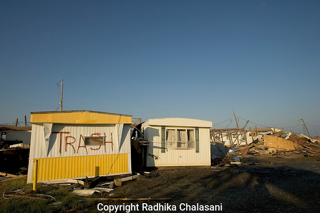 Grand Isle, Lousiana - September 28: trailers in an RV park in this coastal community are marked as trash after Hurricane Katrina struck the Gulf Coast leaving this community and many others devastated in its wake September 28, 2005 in Grand Isle, Louisiana. The community was flooded by both Hurricane Katrina and Rita.  (Photo by Radhika ChalasanI)
