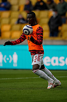 23rd May 2021; Molineux Stadium, Wolverhampton, West Midlands, England; English Premier League Football, Wolverhampton Wanderers versus Manchester United; Eric Bailly of Manchester United warms-up prior to the match