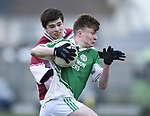 Cian Shannon of  Ennistymon CBS  in action against Anthony Lonergan of  St Declan's Kilmacthomas during their Munster C Colleges football final at Rathkeale. Photograph by John Kelly.