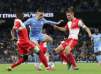 21st September 2021; Etihad Stadium,Manchester, England; EFL Cup Football Manchester City versus Wycombe Wanderers; Phil Foden of Manchester Cityis tackled by Sullay Kaikai and David Wheeler of Wycombe Wanderers