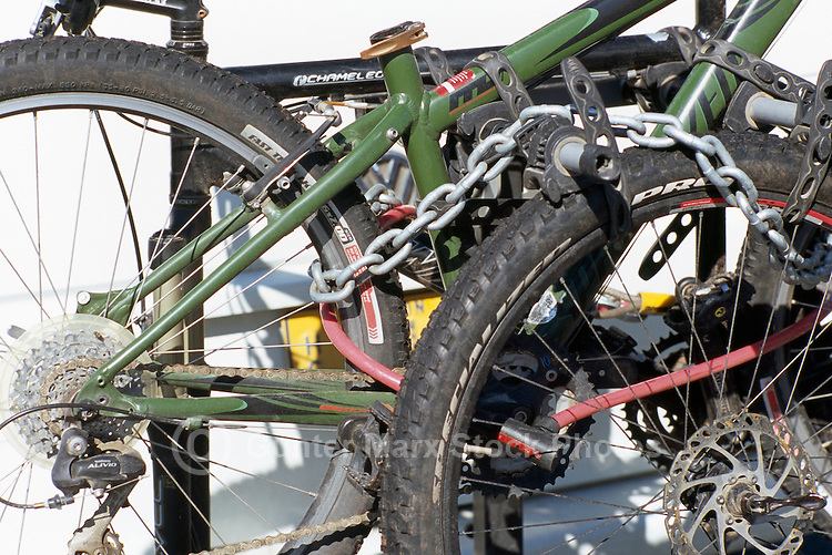 Bicycles locked up and chained together to prevent Bike Theft
