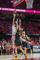 COLLEGE PARK, MD - FEBRUARY 13: Shakira Austin #1 of Maryland shoots over Logan Cook #23 of Iowa during a game between Iowa and Maryland at Xfinity Center on February 13, 2020 in College Park, Maryland.