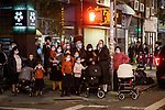 Residents watch a protest against COVID-19 restrictions in the Orthodox Jewish neighborhood Borough Park on Wednesday, October 7, 2020 in the Park in the Brooklyn borough of New York City.  Residents are protesting against new restrictions that would close schools, limit attendance at religious services and close non-essential businesses in areas with surges in COVID-19 cases.  Photograph by Michael Nagle