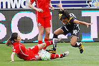 Marta #10 of the Los Angeles Sol gets tangled up with Homare Sawa #10 of the Washington Freedom during their inaugural match at Home Depot Center on March 29, 2009 in Carson, California.