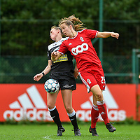 Loes Van Mullem (33) of Eendracht Aalst and Hanne Merkelbach (25) of Standard battle for the ball during a female soccer game between Standard Femina de Liege and Eendracht Aalst dames on the fourth matchday in the 2021 - 2022 season of the Belgian Scooore Womens Super League , Saturday 11 th of September 2021  in Angleur , Belgium . PHOTO SPORTPIX | BERNARD GILLET