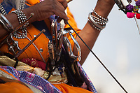 Asia,India,Punjab, Anandpur Sahib, sikh pilgrim sword and knives at  the Holla Mohalla annual festival