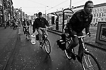 Bicyclists cruise through the streets of  Amsterdam, Netherlands. March 1, 2009.