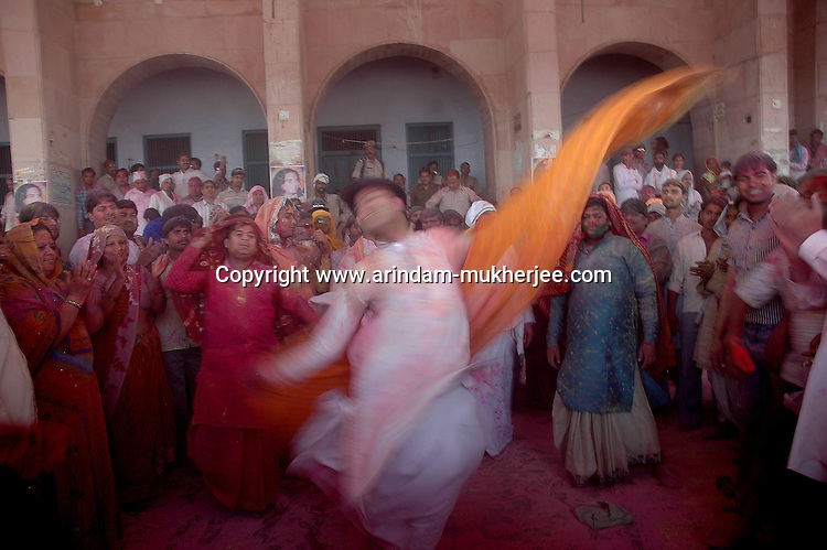 A transsexual dances inside the temple of Radha (Radhika) in Barsana, Uttar Pradesh, India on the day of Lathmar holi. Transexuals are supposed to be holy people in Indian mythology. Lathmar holy is celibrated 7 days before the actual holi day.