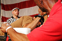 """Harry Wilson, left, battles Milt Christmas at the 28th Annual Big Apple Grapple, held in New York City on March 19, 2005.  The tournament is the first in the 2005 New York Arm Wrestling Association's """"Golden Arm Series""""."""