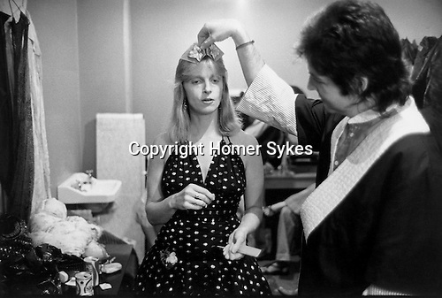 """Paul and Linda McCartney  Wings Tour 1975. Paul and Linda in their  dressing room, Liverpool, England.. The photographs from this set were taken in 1975. I was on tour with them for a children's """"Fact Book"""". This book was called, The Facts about a Pop Group Featuring Wings. Introduced by Paul McCartney, published by G.Whizzard. They had recently recorded albums, Wildlife, Red Rose Speedway, Band on the Run and Venus and Mars. I believe it was the English leg of Wings Over the World tour. But as I recall they were promoting,  Band on the Run and Venus and Mars in particular."""