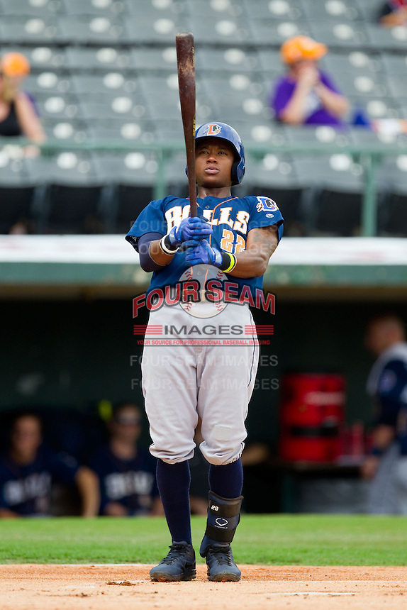 Tim Beckham (22) of the Durham Bulls checks his bat as he gets ready to step into the batters box during the International League game against the Charlotte Knights at Knights Stadium on August 18, 2013 in Fort Mill, South Carolina.  The Bulls defeated the Knights 8-5 in Game One of a double-header.  (Brian Westerholt/Four Seam Images)