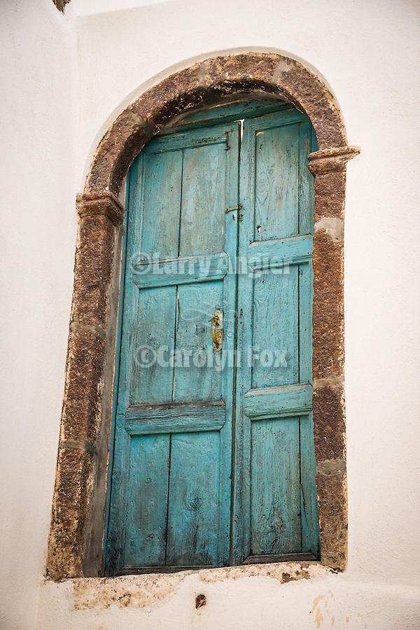 Weathered blue door, arch, Emporio, Santorini, Greece