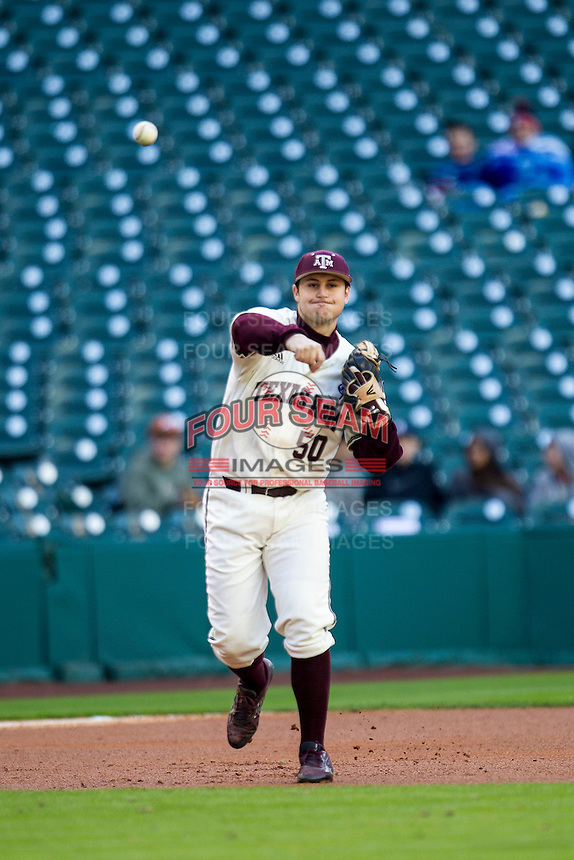 Texas A&M Aggies third baseman Hunter Melton (50) makes a throw to first base during Houston College Classic against the Nebraska Cornhuskers on March 6, 2015 at Minute Maid Park in Houston, Texas. Texas A&M defeated Nebraska 2-1. (Andrew Woolley/Four Seam Images)