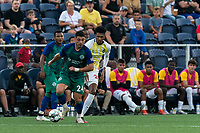 HARTFORD, CT - AUGUST 17: Darwin Lom #24 of Hartford Athletic dribbles as Frank Nodarse #25 of Charleston Battery defends during a game between Charleston Battery and Hartford Athletic at Dillon Stadium on August 17, 2021 in Hartford, Connecticut.