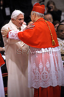 Italian cardinal Lorenzo Baldisseri    is congratulated by Pope emeritus Benedict XVI  after he was appointed cardinal by the Pope at the consistory in the St. Peter's Basilica at the Vatican on February 22, 2014.