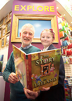 """*** NO FEE PIC***.01/03/2012.Pictured is Irish Author Brendan O' Brien with third class pupil Alison McGovern (8) from Holy Cross National School Dundrum, Dublin at a free reading event of his book """" The Story of Ireland"""" in Eason Dundrum to celebrate the 15th annual World Book Day. To celebrate World Book Day Eason, Ireland's leading retailerof books, stationery, magazines & More have teamed up with some of Ireland'sleading children's writers to deliver a series of events in key stores to mark World Book Day..Photo: Gareth Chaney Collins"""