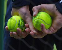England, London, 23.06.2014. Tennis, Wimbledon, official Wimbledon 2014 tennis balls<br /> Photo:Tennisimages/Henk Koster