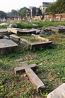 Broken graves in the Scottish Cemetery in central Kolkata.<br /> <br /> To license this image, please contact the National Geographic Creative Collection:<br /> <br /> Image ID: 1925852<br />  <br /> Email: natgeocreative@ngs.org<br /> <br /> Telephone: 202 857 7537 / Toll Free 800 434 2244<br /> <br /> National Geographic Creative<br /> 1145 17th St NW, Washington DC 20036