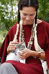Native American Indian Lakota Sioux woman petting a kitten