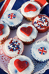"""Party food home made """"cup cakes"""" decorated with red hearts and Union Jack English flags. Prince William Kate Middleton Princess Catherine Royal Wedding Street Party. Barnes London UK. 29 April 2011"""
