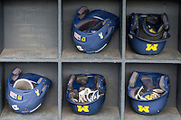 Michigan Wolverines helmet rack on May 3, 2016 at Ray Fisher Stadium in Ann Arbor, Michigan. (Andrew Woolley/Four Seam Images)