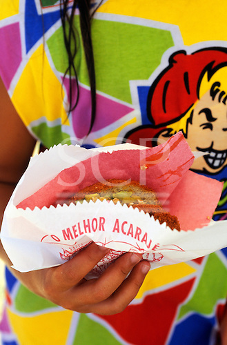"""Salvador, Brazil. Acaraje bean flour patty in a bag which says """"The Best Acaraje (O Melhor Acaraje)"""". Bahia State. Typical snack food"""