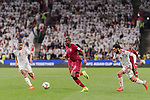 Abdelkarim Hassan of Qatar (C) fights for the ball with Ali Hassan Ali Salmin of United Arab Emirates (L) and Bandar Mohamed Al Ahbabi of United Arab Emirates (R) during the AFC Asian Cup UAE 2019 Semi Finals match between Qatar (QAT) and United Arab Emirates (UAE) at Mohammed Bin Zaied Stadium  on 29 January 2019 in Abu Dhabi, United Arab Emirates. Photo by Marcio Rodrigo Machado / Power Sport Images