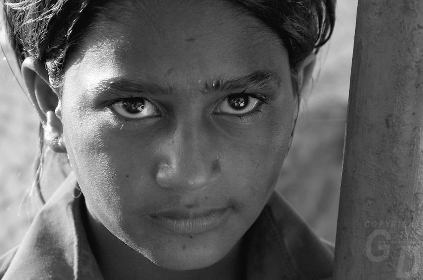 faces of Mumbai, India, a young girl on the road near Bollywood,Mumbai, India