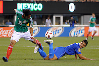 Cristian Noriega (3)of Guatemala controls the ball after falling down as Giovani dos Santos (10) of Mexico watches. Mexico defeated Guatemala 2-1 during a quarterfinal match of the 2011 CONCACAF Gold Cup at the New Meadowlands Stadium in East Rutherford, NJ, on June 18, 2011.