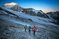 Trail running on the Barrhorn trail at sunrise during the Via Valais, a multi-day trail running tour connecting Verbier with Zermatt, Switzerland.