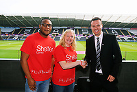 Letou CEO Paul Fox (R) with Sheter Cymru Charity during the English Premier League soccer match between Swansea City and Manchester United at Liberty Stadium, Swansea, Wales, UK. Saturday 18 August 2017
