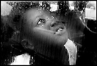 Laquela Dozier, 9, of Daytona Beach looks out of her car window as rains begins to fall Monday afternoon, June 24, 2002 putting a damper on outdoor activities for yet another day. Dozier, and her family where in the parking lot of the Dickerson  Center.