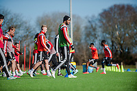 SWANSEA, WALES - FEBRUARY 17:  Ashley Williams of Swansea City warms up before training on February 17, 2015 in Swansea, Wales.  (Photo by Athena Pictures )