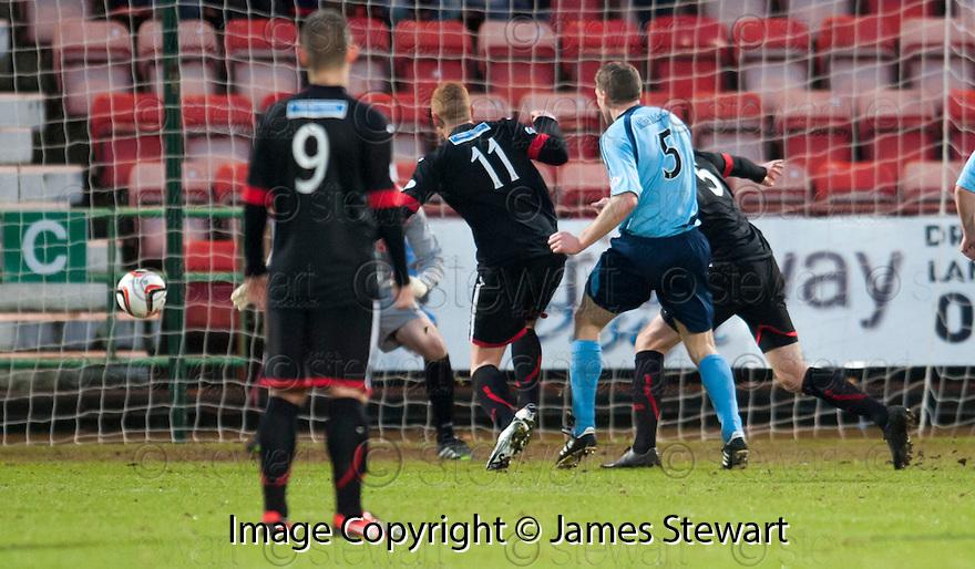 Forfar's Darren Dods (5) scores their first goal.