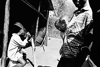 Rwanda. Gitagata. Prison for 152 children, aged 4 to 14, all convicted for active involvement (murder) in the 1994 rwandese genocide. Reeducation camp for minors. A boy chops wood with a machete. © 1995 Didier Ruef