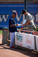 Reading Fightin Phils hitting coach John Mizerock (12) signs autographs for a fan before a game against the Erie SeaWolves on May 18, 2017 at UPMC Park in Erie, Pennsylvania.  Reading defeated Erie 8-3.  (Mike Janes/Four Seam Images)