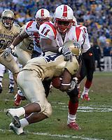 Louisville linebacker Malik Jackson (11) tackles Pitt running back LaRod Stephens-Howling.  The Louisville Cardinals defeated the Pitt Panthers 48-24 on November 25, 2006 at Heinz Field, Pittsburgh, Pennsylvania.