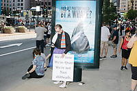 """A counter-protestor is seen with a sign reading """"We're here / We're queer / We're not Nazi shitheads,"""" after the Straight Pride Parade in Boston, Massachusetts, on Sat., August 31, 2019."""