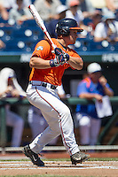 Virginia Cavaliers catcher Matt Thaiss (21) follows through on his swing against the Florida Gators in Game 11 of the NCAA College World Series on June 19, 2015 at TD Ameritrade Park in Omaha, Nebraska. The Gators defeated Virginia 10-5. (Andrew Woolley/Four Seam Images)