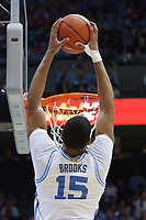 CHAPEL HILL, NC - FEBRUARY 25: Garrison Brooks #15 of the University of North Carolina dunks the ball during a game between NC State and North Carolina at Dean E. Smith Center on February 25, 2020 in Chapel Hill, North Carolina.