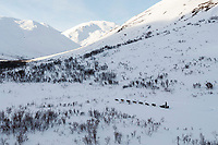 Pete Kaiser runs into the very beginning of Rainy Pass valley on the way to Rohn in the Alaska Range during the 2019 Iditarod on Monday, March 4th 2019.<br /> <br /> Photo by Jeff Schultz/  (C) 2019  ALL RIGHTS RESERVED