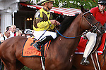 Antigun enters track. Favorite Alpha with Ramon Dominguez and long shot Golden Ticket dead heat in the Grade I $1,000,000 Travers Stacks.  Alpha Trainer: Kiaran McLaughlin. Owner Godlphin Racing. Golden Ticket trainer Ken McPeek.  Owner Magic City Thoroughbred.