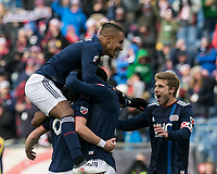 Foxborough, Massachusetts - March 10, 2018: In a Major League Soccer (MLS) match, New England Revolution (blue/white) defeated Colorado Rapids (yellow/blue), 2-1, at Gillette Stadium.<br /> Chris Tierney scored game winning goal in extra time. Players celebrate game victory.