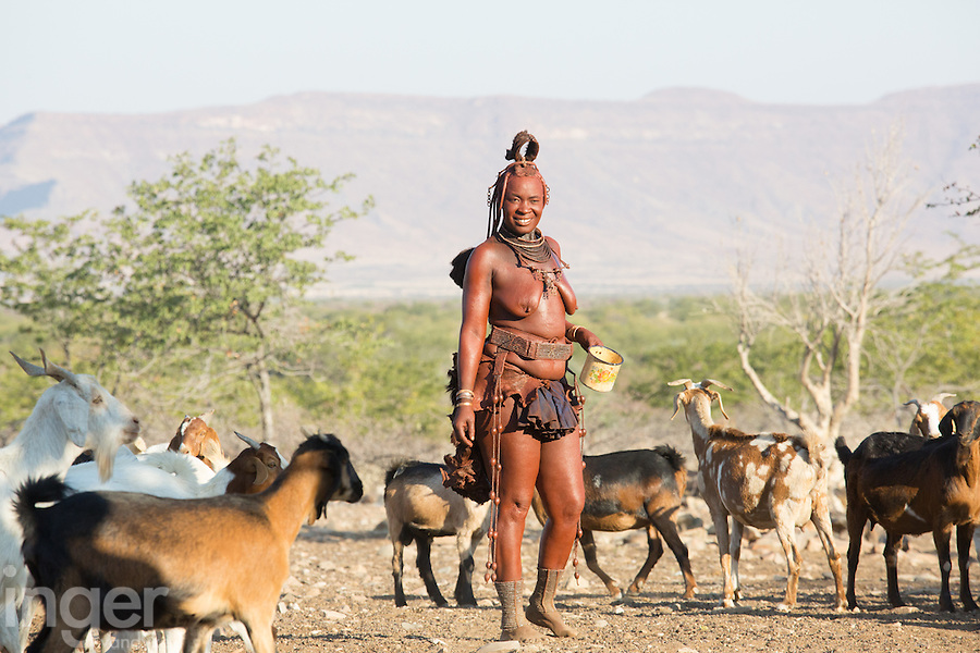 Himba lady herding her goats in remote Kaokoland, Namibia