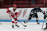 BOSTON, MA - FEBRUARY 16: Courtney Correia #5 of Boston University brings the puck forward during a game between University of New Hampshire and Boston University at Walter Brown Arena on February 16, 2020 in Boston, Massachusetts.