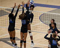 Trinity Luckett (5) of Bentonville West spikes ball against Olivia Hall (1) and Brooklyn Weaver (27) of Rogers at Rogers High School, Rogers, AR, on Thursday, September 9, 2021 / Special to NWADG David Beach