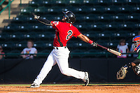 Eduard Pinto (2) of the Hickory Crawdads follows through on his swing against the Savannah Sand Gnats at L.P. Frans Stadium on June 14, 2015 in Hickory, North Carolina.  The Crawdads defeated the Sand Gnats 8-1.  (Brian Westerholt/Four Seam Images)