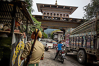 Indian border police speak to each other near the Buthan gate which marks the border point between India and Bhutan and is one of the main smuggling routes for tiger parts trafficked between India and China.